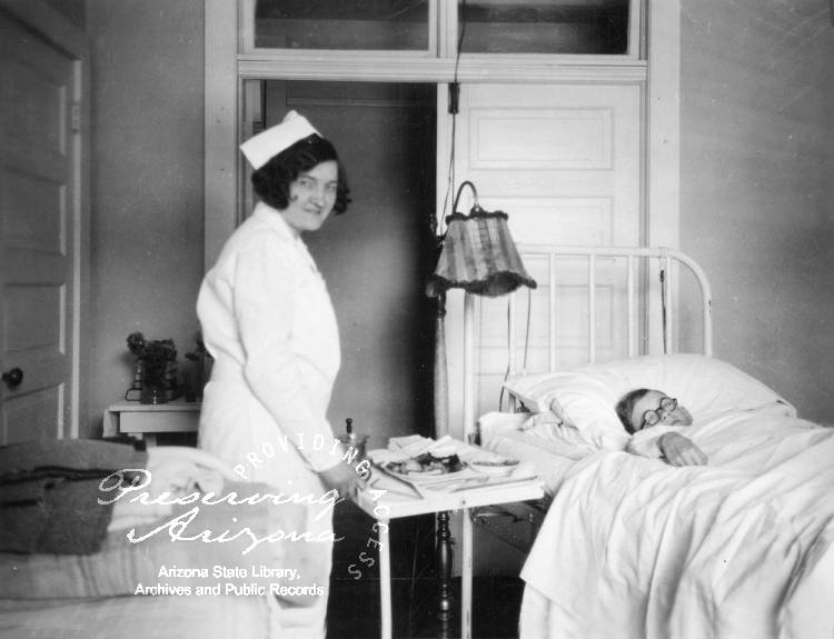 Photograph of a nurse working with a patient in the hospital at the