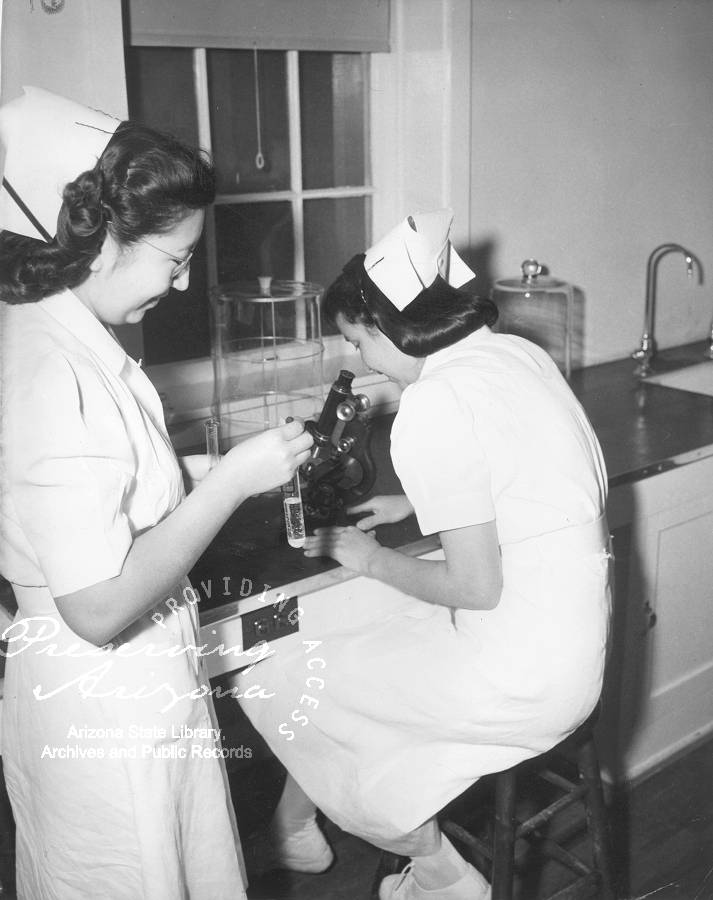 Photograph of two nurses working in the laboratory at Sage Memorial