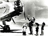 Navajo men and boys with Grand Canyon Airlines tri-motor