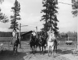 Four cowboys on saddled horses, Foxboro Ranch