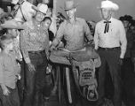 Young rodeo rider receives a saddle at the Florence Junior Parada