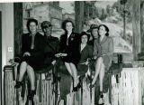 Group of Women Sitting on Saddles at the Arizona Exhibit in the Hall of Western States, Golden...