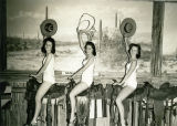 Three Young Women in Bathing Suits on Saddles at the Arizona Exhibit in the Hall of Western...