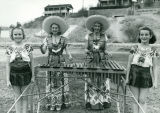 Students in Mexican Costumes Playing a Xylophone on Wheels for the Nogales High School Marching...