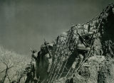 African American Soldiers Climbing a Rock Cliff. Training at Fort Huachuca, Arizona