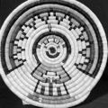 Hahay'I wuuti (Katsina Mother) coiled plaque with a rainbow design