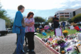 Photo of two UMC employees viewing the  tributes at University Medical Center
