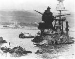 Photograph of the Battleship U.S.S. Arizona the day following its bombing on December 7, 1941