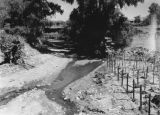 Photograph of an arroyo, water drainage ditch, in Nogales (Ariz.)