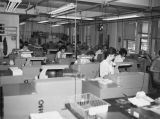 Photograph of the employees and machinery of the data processing department at the Arizona Highway...