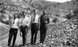 Photograph of Walter Ehle,  John Hennesey, Harry Shea and Omer Williams on a road in the Arizona...