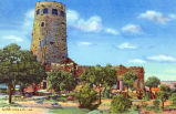 Photograph/colorized postcard of the Watchtower, a stone building at the Grand Canyon National...