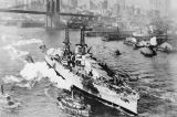 Photograph of the U.S.S. Arizona as it is towed near the Brooklyn Bridge in New York (N.Y.)