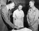 Photograph of Arizona Governor Paul Fannin cutting a cake, probably during a ceremony,  at Luke...