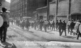 Photograph of a group of laborers being marched out of the town of Bisbee (Ariz.) following a...
