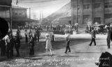Photograph of a group of laborers gathering to be marched out of the town of Bisbee (Ariz.)...
