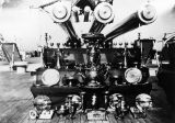Photograph of armament and trophies aboard the U.S.S. Arizona.