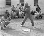 Photograph of airmen playing baseball at Luke Air Force Base in Glendale (Ariz.)