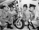 Photograph of mechanics working on an airplane at Luke Air Force Base (Ariz.)