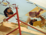 Photograph/color image of the stencil work being completed as part of the restoration of the...
