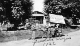 Photograph of a campaign sign for Arizona Governor George W.P. Hunt, being hauled by a mule, in...