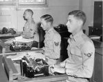 Photograph of military personnel learning to use typewriters at Luke Air Force Base in Glendale...