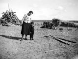 Photograph of a Navajo mother and child on the Navajo Indian Reservation of northern Arizona.