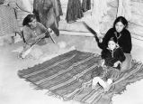 Photograph of a Navajo family in a hogan on the Navajo Indian Reservation in northern Arizona.