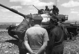 Photograph of Arizona Governor Raul Castro and a group of soldiers at a tank training event at...