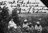 Photograph of a group of people on a hill overlooking Ayuthaya (Siam)