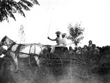 Photograph of an unidentified woman and girl riding a buggy in Phoenix (Ariz.).