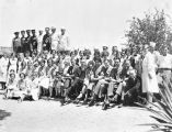 Photograph of a group of Fred Harvey Company employees at the Grand Canyon (Ariz.)