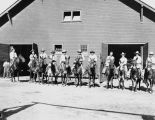 Photograph of a group of visitors about to ride mules at the Grand Canyon (Ariz.)