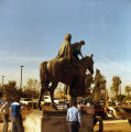 Photograph/color image of a people watching the installation of a statue of Father Kino on the...