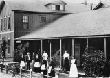 Photograph of an unidentified group of Harvey Co. employees at one of the earliest hotels in...