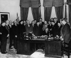Photograph of U.S. President Harry Truman and other men at the signing of the Colorado River Pact.
