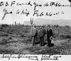 Photograph of Arizona Governor George , O.S. French and George Dix on the desert in Pinal County...
