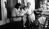 Photograph of the daughter of George , Virginia  Brannen, with her son Carl and Minnie Ellison on...