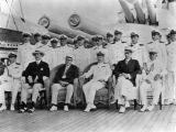 Photograph of officers aboard the gun deck of the U.S.S. Arizona.