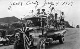 Photograph of Arizona Governor George  riding a decorated truck during a July 4th parade in Globe...
