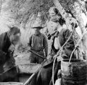 Photograph of workers drawing water from a water tank in Cave Creek (Ariz.)