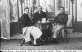 Photograph of Lia Ting, Tom Coleman and Wu Ying at tea in Canton (China).