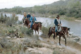 Photograph of tourists horseback riding in Tanque Verde, near Tucson (Ariz.).