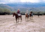 Photograph of tourists riding horses in Tanque Verde, near Al Marah Ranch in Tucson (Ariz.).