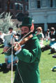 Photograph of Sol Rudnick playing fiddle at a St. Patrick's Day event in Phoenix (Ariz.).