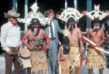 Photograph of Governor Bruce Babbitt posing with Indian dancers at the Arizona State Capitol in...