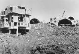 Photograph of workers constructing the architectural experiment at Arcosanti, Cordes Junction...