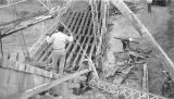 Photograph of damage to the Zuni River Bridge on United States Highway 191 in Apache County...