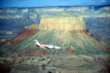 Photograph/color image of an airplane flying a scenic flight at the Grand Canyon (Ariz.).