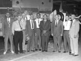 Photograph of a group of Arizona State Senators visiting an aircraft facility in Goodyear (Ariz.).